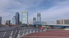 Woman talks on cell phone, Jacksonville skyline, Florida, USA Stock Footage