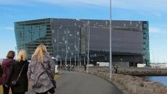Reykjavik, Iceland - SEP, 2016: people are strolling on embankment of Reykjavik Stock Footage