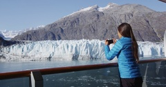 Tourist on Alaska cruise ship taking photo of glacier in Glacier Bay Stock Footage