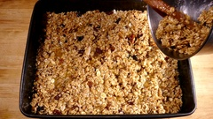 Hands filling a baking tray with flapjack mix. Stock Footage