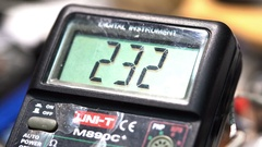 Master measures the temperature with a multimeter Stock Footage