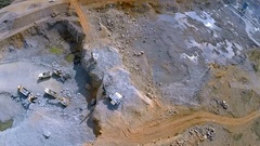 Work equipment in mining granite stone quarry. Aerial footage Stock Footage