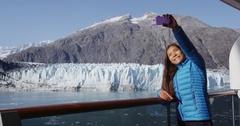 Alaska cruise ship passenger taking selfie photo by glacier in Glacier Bay Stock Footage