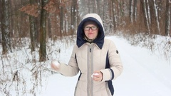 Beautiful woman throwing a snowball Stock Footage