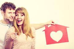 Happy pair holding symbols. Stock Photos