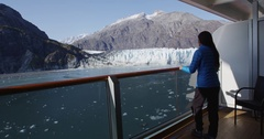 Tourist on cruise ship travel in Alaska looking at glacier from balcony Stock Footage