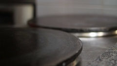 Chef lubricating pan with oil and preparing pancake Stock Footage