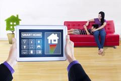 Controller app of smart house on tablet Stock Photos