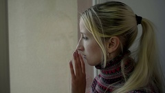 Close Up Frustrated Young Girl Looking out the Window at Home Stock Footage