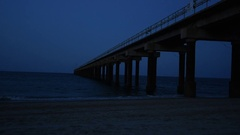 Peer on Beach at Night Stock Footage