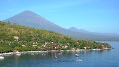 4K Jemeluk Beach and beautiful blue lagoon with Gunung Agung volcano on backgrou Stock Footage