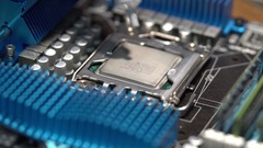 Master puts thermal paste on the CPU Stock Footage