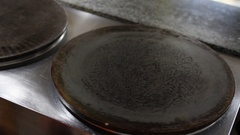 Preparing pancake. view from behind the shoulder Stock Footage