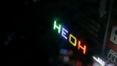 Neon sign in the reflection in a puddle Stock Footage