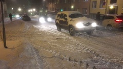 Cars on snow covered road in winter in Stockholm Stock Footage