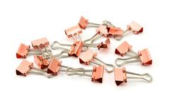 Copper-coloured metal binder clips Stock Photos