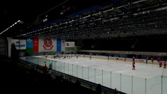 Hockey players go on the ice arena before the match Stock Footage