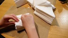 Female hands folding a lot of napkins. Stock Footage