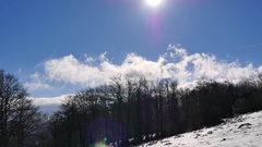 Fast moving clouds, view from mountain during winter time Stock Footage