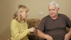 Senior woman rubs ointment for back pain man overweight. Husband picked up a T Stock Footage
