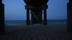 Under a Peer on the Beach Stock Footage