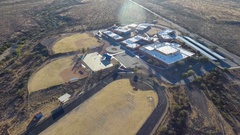 Aerial orbit of a public school campus Stock Footage