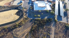Aerial flyover of a public school campus Stock Footage