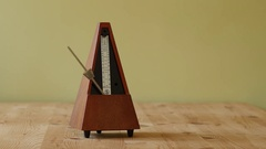 Mechanical Metronome Measuring Music Tempo Stock Footage