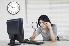 Worker observe computer in office Stock Photos