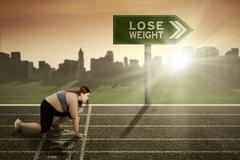 Woman ready to lose weight concept Stock Photos