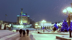 Maidan square pan from Independence Monument to Post Office snowing at night Stock Footage