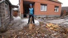 Sporty man chops firewood on a farm Stock Footage