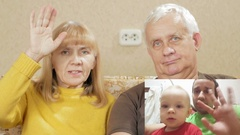 Senior couple communicates with the son and grandson on the internet. PIP: see Stock Footage