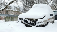 Old broken car under the snow. Abandoned automobile Stock Footage