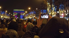 Unrecognizable tourists recording videos and shooting photos of New Year light Stock Footage