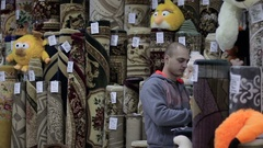 Customers choosing and buying floor covering in carpet store Stock Footage
