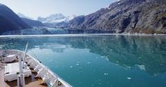Alaska cruise ship passenger taking photo of glacier in Glacier Bay Stock Footage