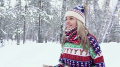 Attractive blond woman jogging in the forest on a winter day Stock Footage