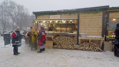 The fairground barkers in national costumes dancing on Christmas Fair Stock Footage