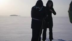 People untangle tangled slings kiteboarding, 4k Stock Footage