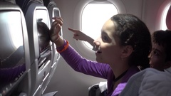 Kids enjoy In flight entertainment known as IFE Stock Footage