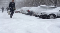 Alley Covered In Snow, Old Man Stumbling, Cars Almost Buried In Snow Stock Footage