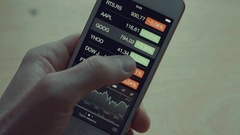 Man hand scrolling stock market indices Stock Footage