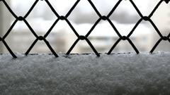 Snowing Detail From A Detaining Center Window, Rack Focus Stock Footage