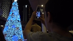 BANGKOK 17 DEC 2016 Kid Taking picture of a christmas tree Stock Footage
