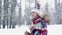 Close-up of an attractive fair-skinned young woman jogging in the winter forest Stock Footage