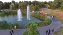 The lake in the park with forfeits out of the water  View from quadroc Stock Footage