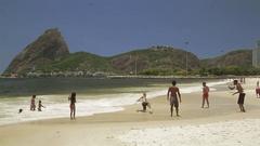 Playing soccer beach, Altinho Sugar Loaf  Stock Footage