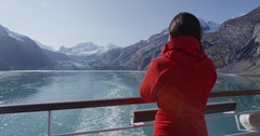 Glacier Bay Alaska cruise ship passenger looking at glacier Stock Footage