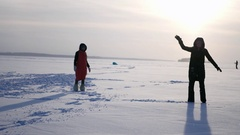 Beautiful young girl trying to make somersault on snow, 4k Stock Footage